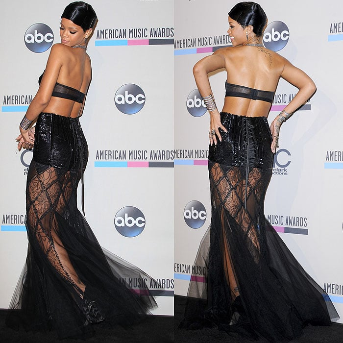 Rihanna poses and shows off the lace-up corset detailing on her Jean Paul Gauthier dress