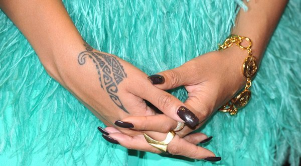 Rihanna showing off her hand tattoos and jewelry