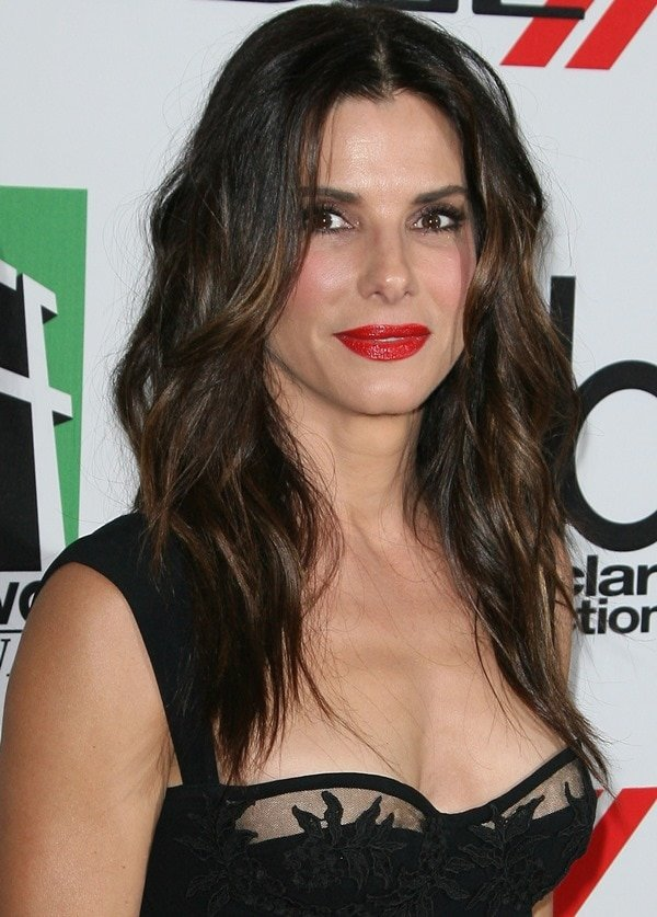 Sandra Bullock embraced her inner sexy vixen at the 17th Annual Hollywood Film Awards