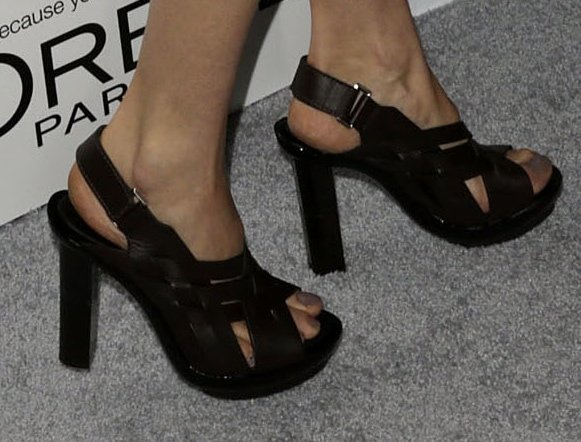 Shailene's feet in woven leather sandals