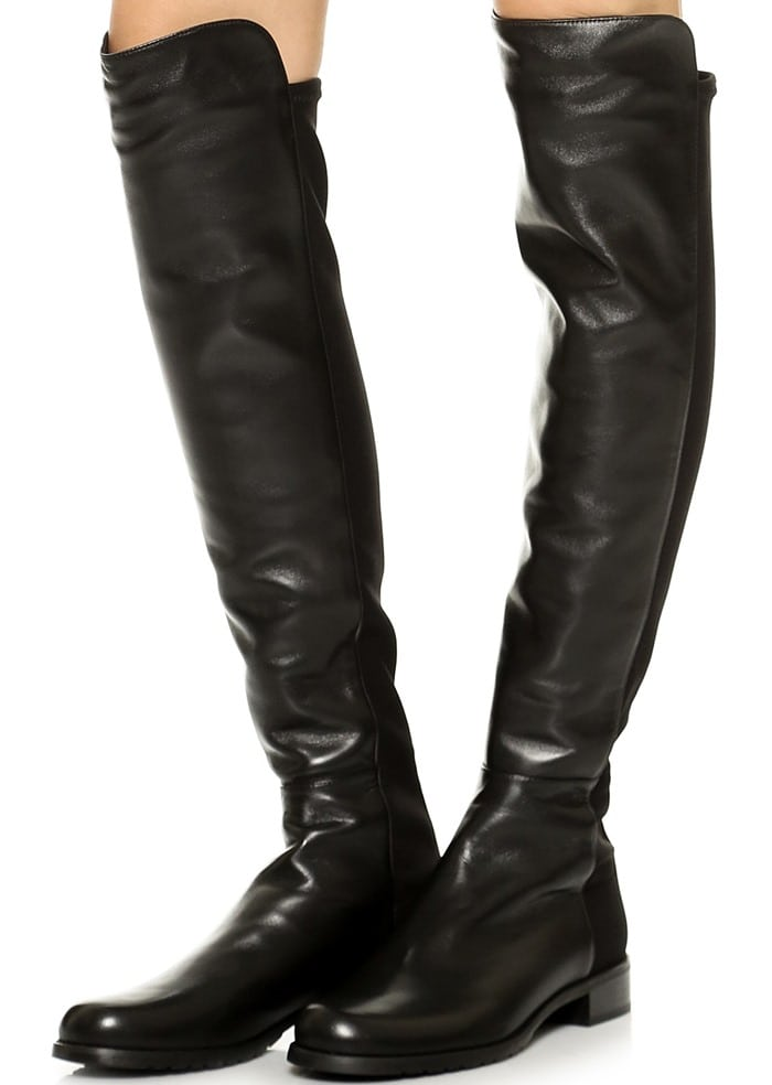 Stuart Weitzman's iconic 5050 over-the-knee boot in supple leather is fitted with a stretchy back panel for a sleek, comfortable fit that adjusts perfectly to your silhouette, making this wardrobe-staple style a favorite among editors, stylists, and celebrities