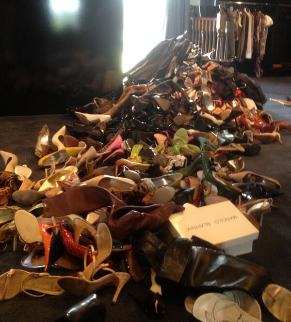 Victoria Beckham's pile of shoes to donate takes over a portion of a room