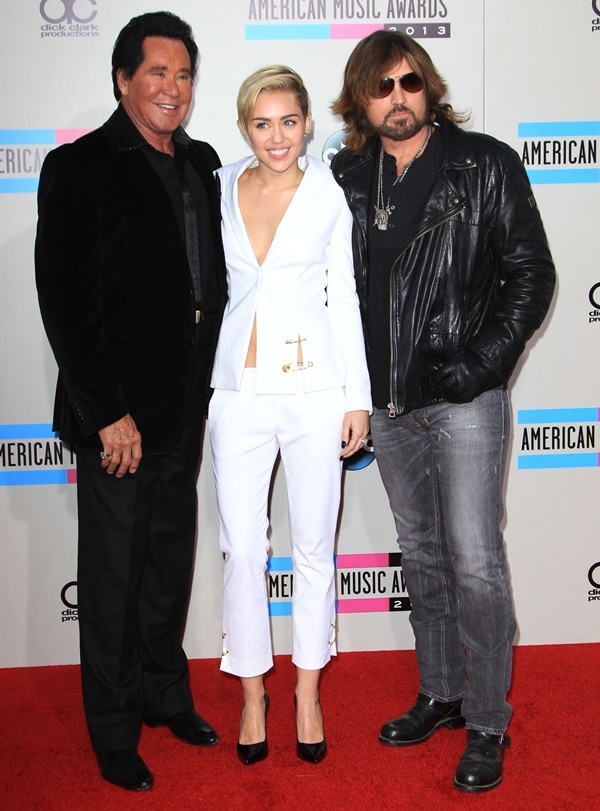 Wayne Newton, Miley Cyrus and Billy Ray Cyrus all pose on the red carpet