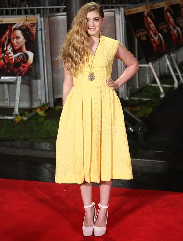Willow Shields brightened up the red carpet in a lemon yellow sleeveless frock from Emilia Wickstead