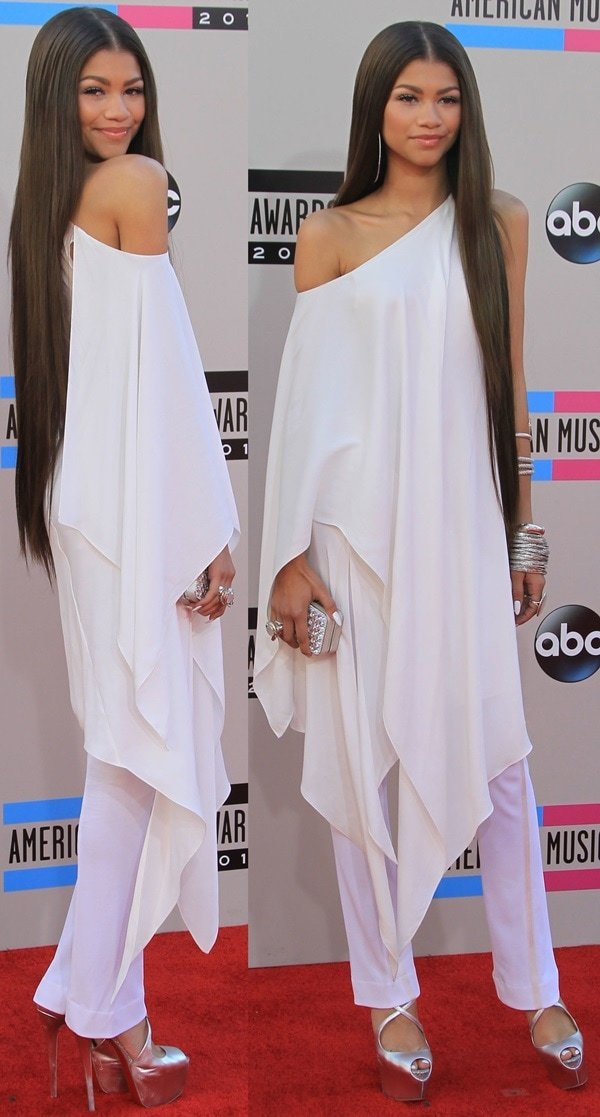 Zendaya Coleman paired a one-shoulder tunic top and with white pants