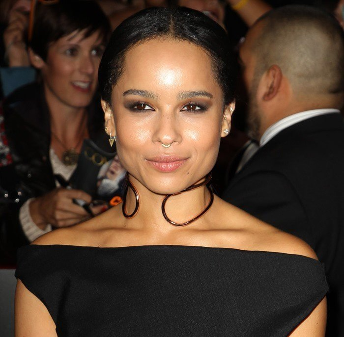 """Zoë Kravitz wears her hair parted and back at the red carpet premiere of the latest """"Hunger Games"""" movie"""