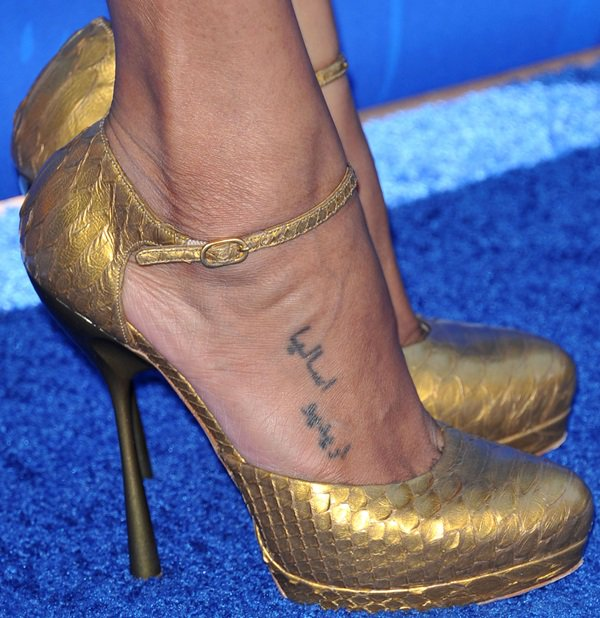 Zoe Saldana showing off her foot tattoos in gold metallic Alexander McQueen pumps