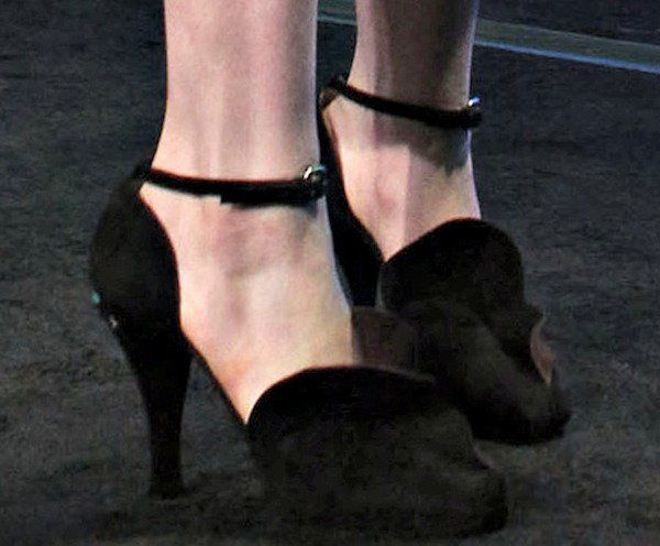 Anne Hathaway wearing black suede d'Orsay pumps from Prada