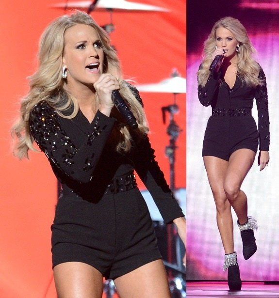 Carrie Underwood performs at the CMAs in a long-sleeved black onesie