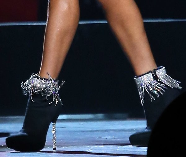 Carrie Underwood completes her CMAs outfit with a pair of silver-fringed black booties