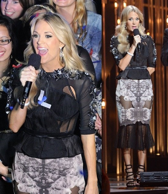 Carrie Underwood wears a sheer black two-piece outfit