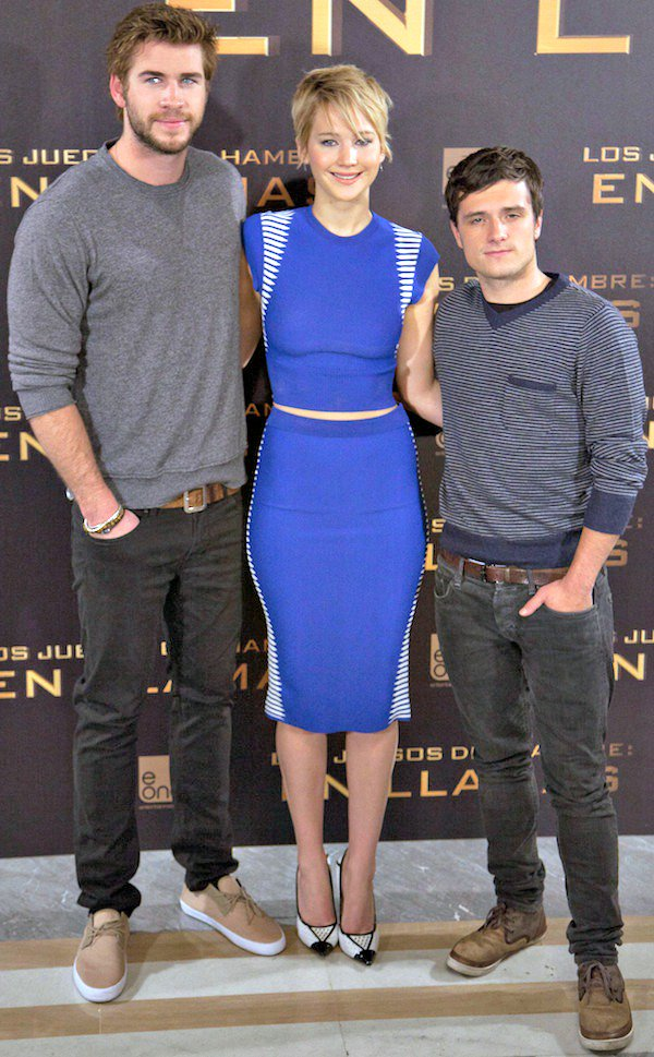 Jennifer Lawrence looking gorgeous in electric blue as she joins co-stars Liam Hemsworth and Josh Hutcherson at The Hunger Games: Catching Fire photo call