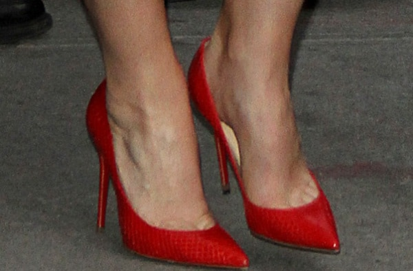 Claire Danes showing off her feet in spicy red pointy-toe pumps