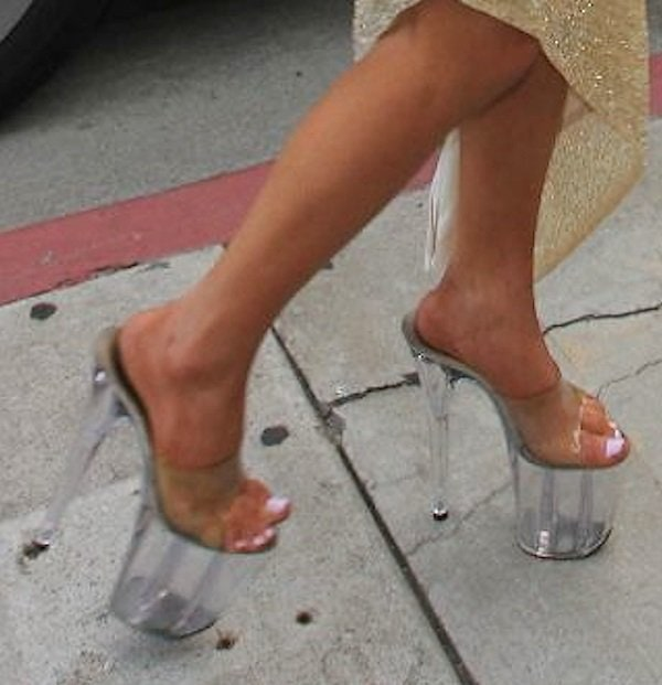 Courtney fashions sky-high clear hooker shoes with super platforms