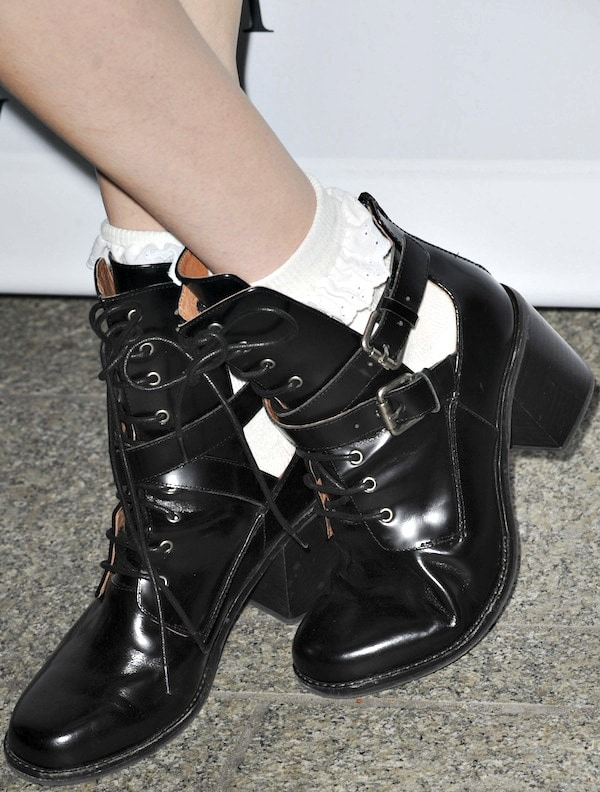 Dani Thorne's black leather ankle boots and white lace ankle socks