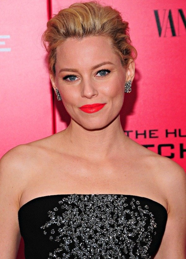 Elizabeth Banks wears a Jenny Packham jumpsuit and bright red lipstick on the red carpet