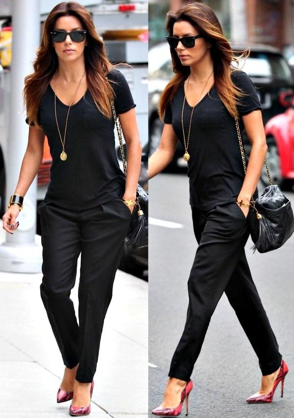 Eva Longoria wearing a plain black shirt with matching dark trousers