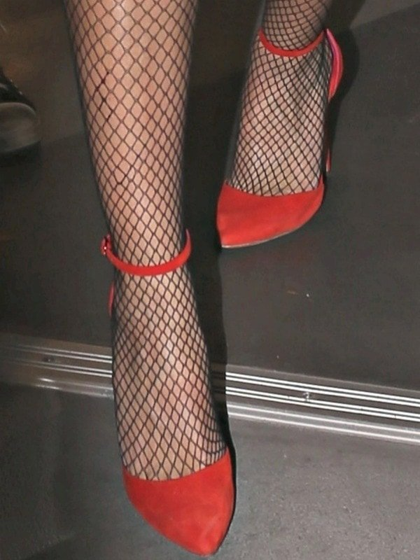 "Heidi Klum in fishnet stockings and red ""Iman"" d'Orsay pumps"