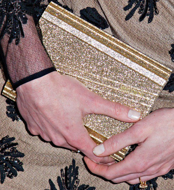 Hilary Rhoda carried a gold clutch from Jimmy Choo
