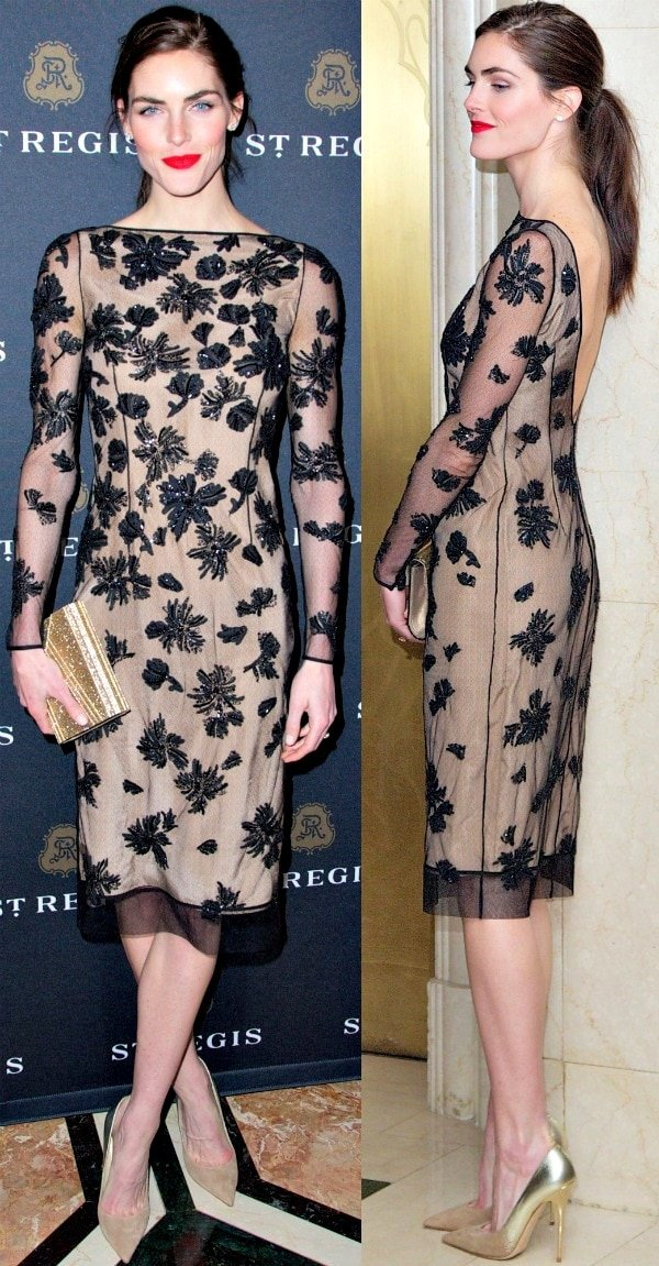 Hilary Rhoda in a sheer long-sleeved dress with an open back, nude lining, and floral embroidery
