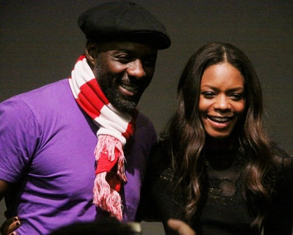 Naomie Harris with co-star Idris Elba at a panel discussion for their film, Mandela: Long Walk to Freedom, held at the Apple Store in the SoHo district of New York City, New York, on November 22, 2013