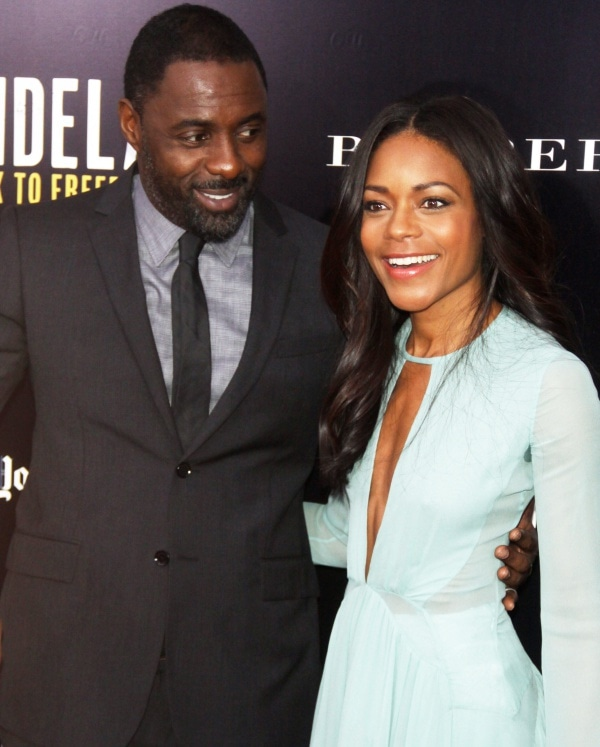 Naomie Harris with co-star Idris Elba at a special screening of Mandela: Long Walk to Freedom held at Ziegfeld Theatre in New York City, New York, on November 25, 2013