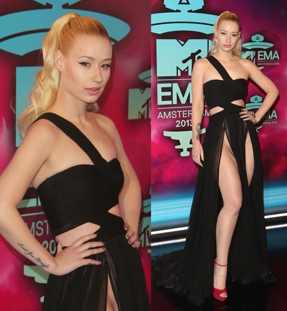 Iggy Azalea wears a sexy crotch-high slitted gown and red platform sandals