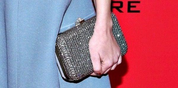 Jena Malonetoting a silver clutch from Valentino