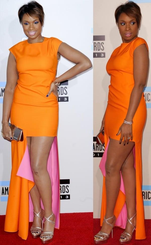 Jennifer Hudson was a burst of sunshine in a high-low bright orange dress from Christian Dior