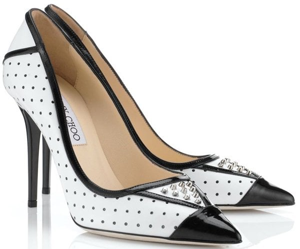 These pumps are crafted from a mix of punctured white leather and black patent leather for the trimmings