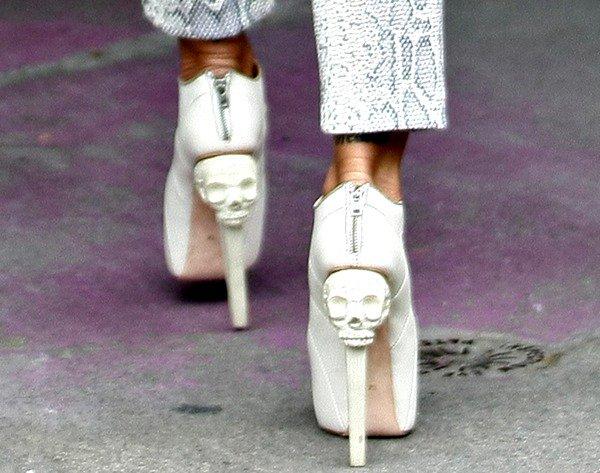 Jodie Marsh wearing towering skull-heeled pumps