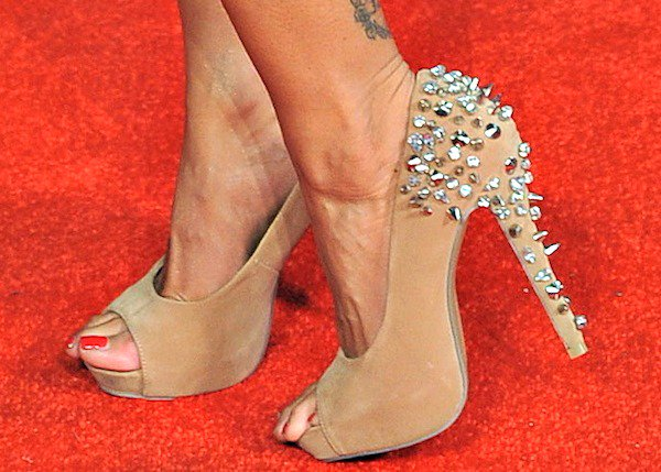 Jodie Marsh in nude peep-toe pumps embellished with studs on the rear and heels