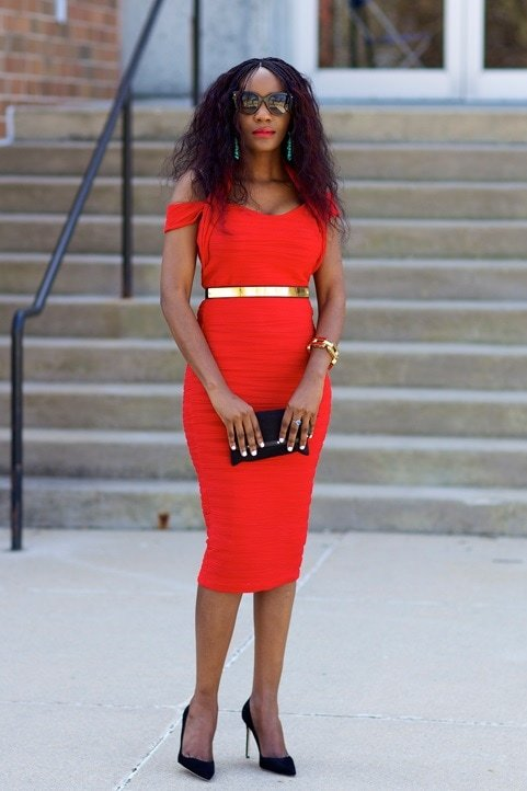 Blogger Patie of Just Patience stylishly pairs her black pumps with a persimmon-hued dress and gold accessories