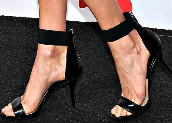 """The statuesque beauty capped off her look with the """"Barbara"""" ankle-strap sandals from the Michael Kors Fall 2013 collection."""