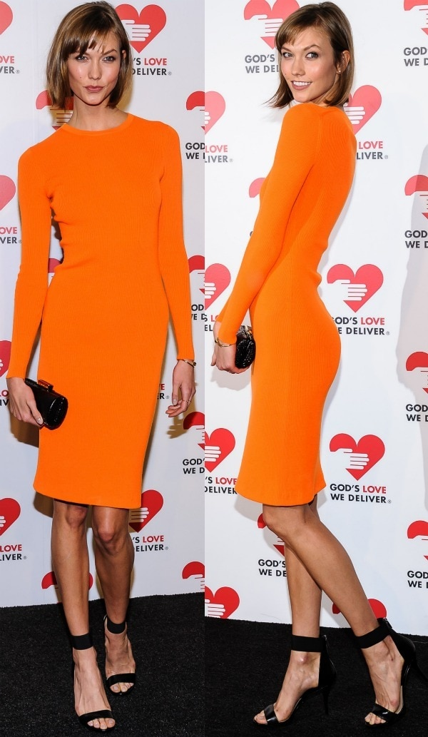 Karlie Kloss brightened up the red carpet at the God's Love We Deliver 2013 Golden Heart Awards Celebration in an orange figure-hugging and long-sleeved dress from Michael Kors