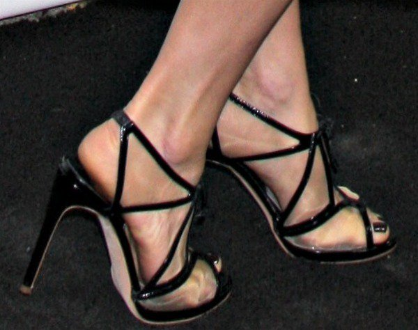 """Katie wearing black """"Harting"""" sandals from Rupert Sanderson's Spring 2013 collection"""