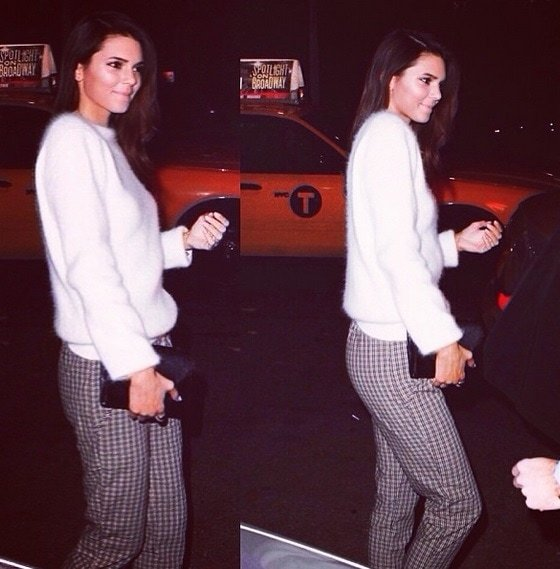 Kendall Jenner wears a cashmere sweater and patterned trousers for the Mario Testino photo exhibit on November 18, 2013