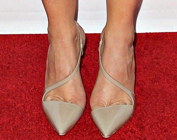 Kristen Wiig's feet in Christian Louboutin pumps