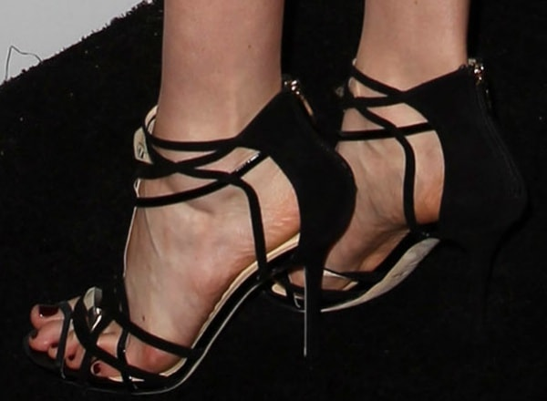 Krysten Ritter shows off her feet in black Cooler sandals from Jimmy Choo