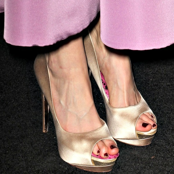 Krysten Ritter shows off her feet in champagne satin pumps from Rupert Sanderson