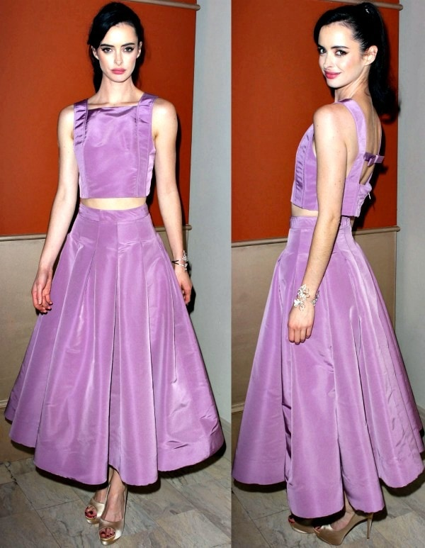 Krysten Ritter looked lovely in a Spring 2014 orchid crop top and a retro-style pleated skirt from Katie Ermilio