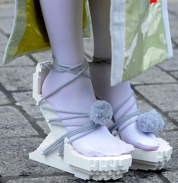 Lady Gaga wearing white lego heels from Winde Rienstra