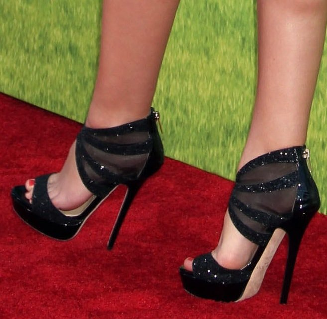 Leighton Meester wearing glittery mesh-detailed sandals from Jimmy Choo