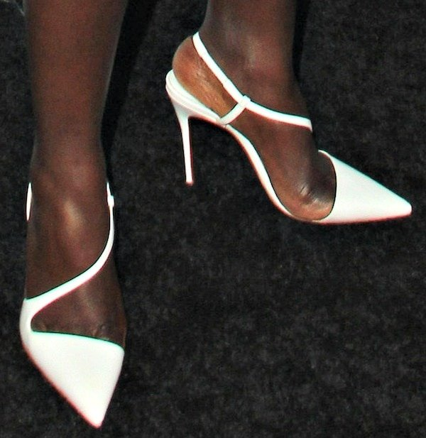 Lupita Nyong'o wearing white slingback pumps from Christian Louboutin