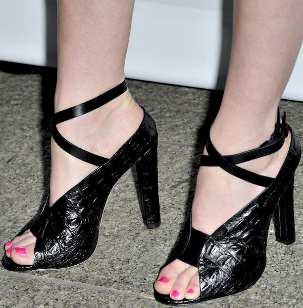 Lydia Hearst's pedicured feet in croc-embossed sandals from Alexander Wang