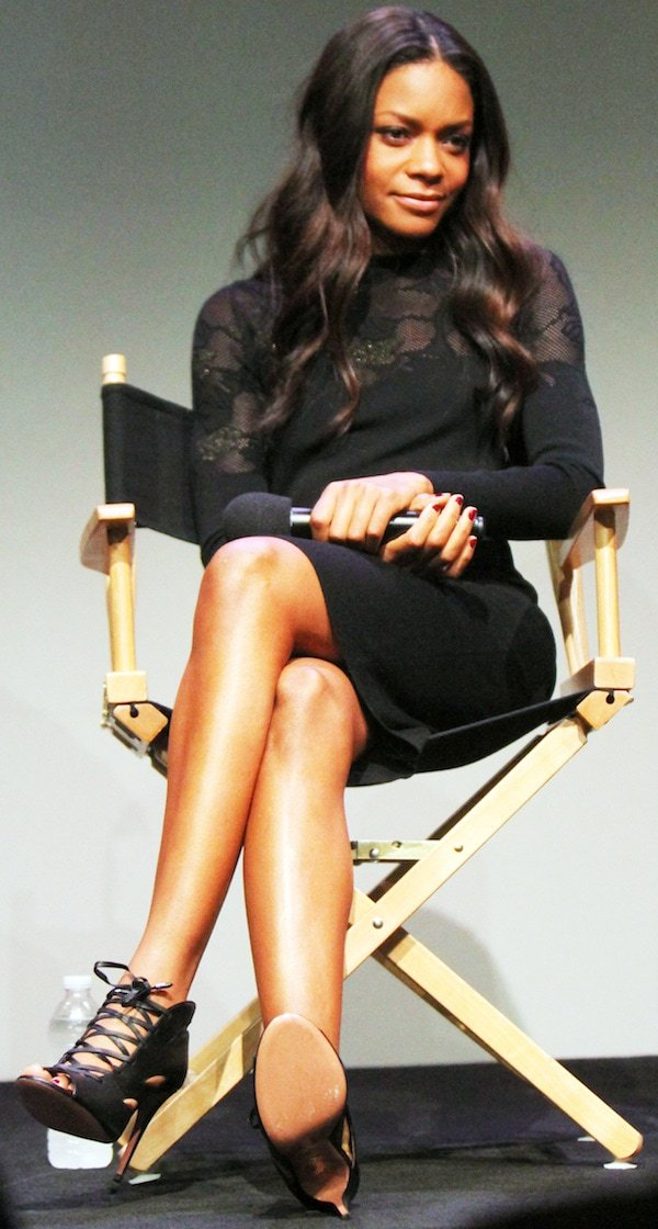 Naomie Harris wearing a long-sleeved, figure-hugging black dress from Azzaro