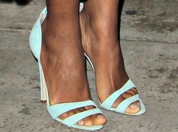 Naomie Harris wears a pair of aqua suede sandals from Oscar de la Renta on her feet