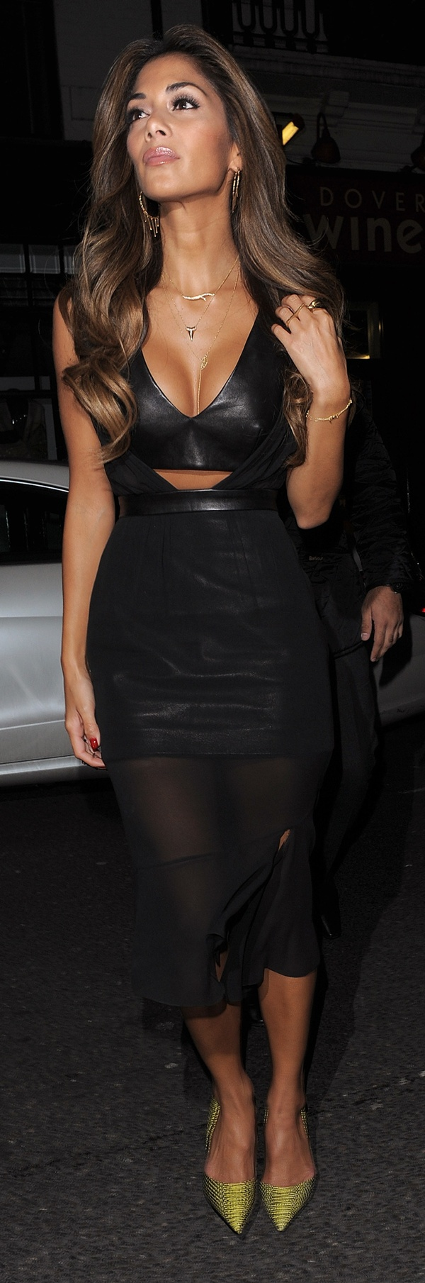 Nicole Scherzinger paired her heels with a black Guy Laroche outfit that included a leather bustier, a leather miniskirt, and a chiffon overlay