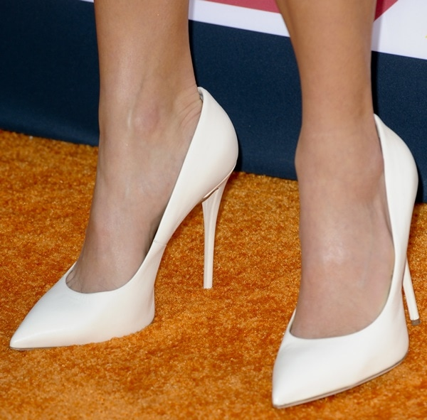 Nikki Reed wearing white Giuseppe Zanotti pumps at the 2013 TeenNick HALO Awards