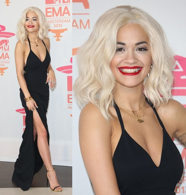 Rita Ora wears a classic black gown from Calvin Klein and gold-and-black ankle-strap sandals